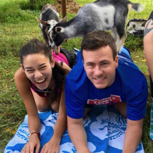 Goat yoga couple with goats