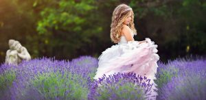 Young girl in lavender field at Mad Lavender Farm