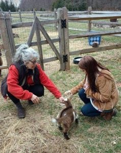 Jenn and Adrienne with baby goat