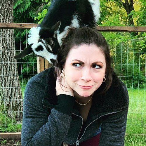 Goat Yoga with goat on back